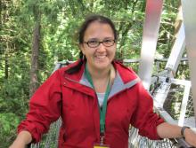 Minutes from her computer science lab, Leigh-Anne Mathieson takes a research break at UBC's treetop walkway