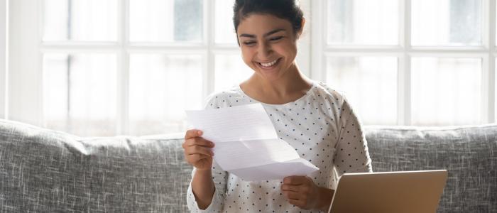 girl opening letter